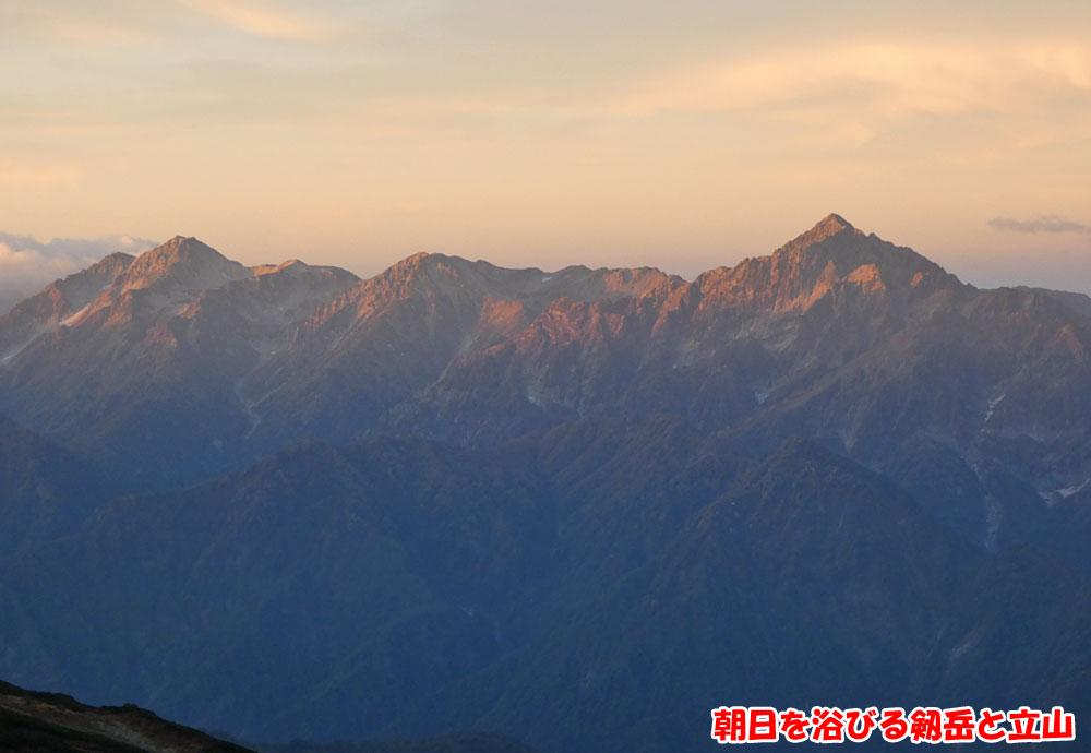 朝日を浴びる剱岳と立山